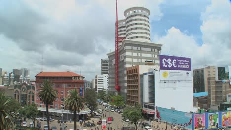 Slow-tilt-down-to-streets-of-Nairobi-Kenya-with-pedestrians-and-traffic