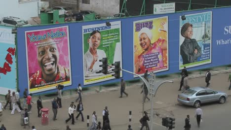 Handprinted-billboard-signs-along-a-busy-street-in-kenya