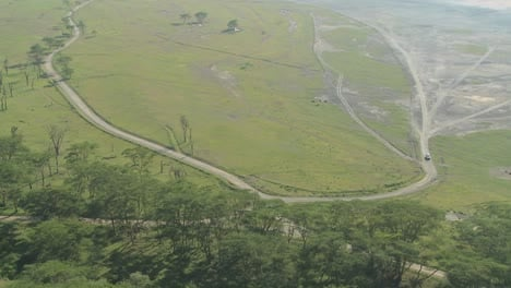 A-safari-jeep-travels-on-a-distant-road-in-Africa