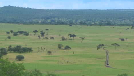 A-safari-jeep-travels-on-a-distant-road-in-Africa-3