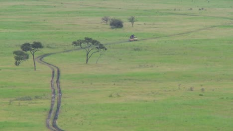 A-safari-jeep-travels-on-a-distant-road-in-Africa-4