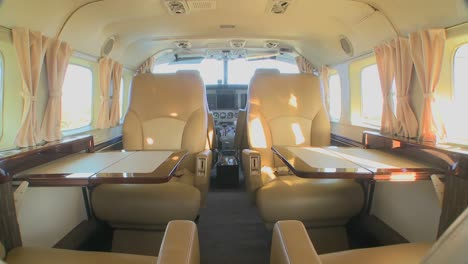 Dolly-forward-through-the-interior-of-a-corporate-luxury-jet