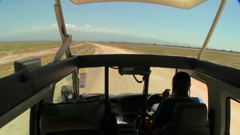 POV-shot-driving-in-an-open-topped-safari-vehicle-through-Africa-2