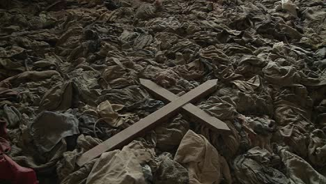 A-cross-sits-amongst-the-scattered-clothing-of-victims-following-a-genocide-in-a-church-in-Rwanda