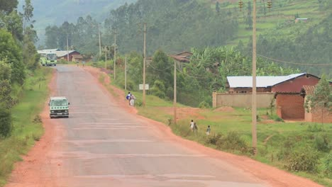 A-minibus-travels-down-a-rural-road-in-Rwanda