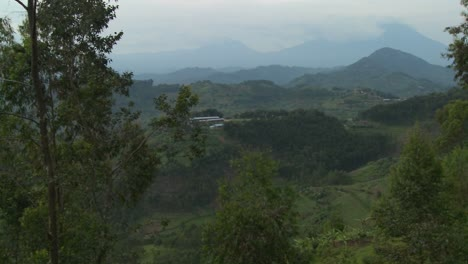 Slow-pan-across-the-lush-landscapes-surrounding-the-Virunga-volcanos-on-the-Congo-Rwanda-border