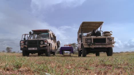 Safari-jeeps-are-parked-on-the-plains-of-Africa