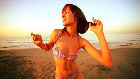Woman-Dancing-On-Beach-43