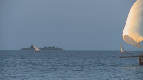 A-beautiful-dhow-sailboat-moves-past-the-coast-of-Zanzibar