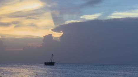A-distant-boat-sails-along-the-shores-of-Zanzibar-at-sunrise