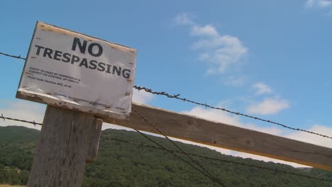 Time-lapse-of-clouds-drifting-past-a-no-trespassing-sign-1