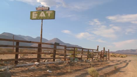 Pan-shot-across-and-abandoned-diner-with-a-sign-saying-eat