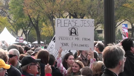 People-hold-up-funny-signs-at-the-Jon-Stewart-Stephen-Colbert-rally-in-Washington-DC