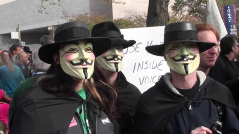 Three-masked-men-posing-at-the-Jon-Stewart-rally-in-Washington-DC