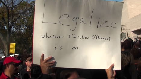 A-person-holds-up-a-sign-saying-legalize-whatever-Christine-ODonnell-is-on-at-the-Jon-Stewart-rally