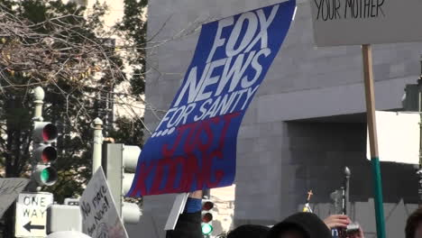 A-sign-at-a-rally-says-Fox-News-For-Sanity-Just-Kidding