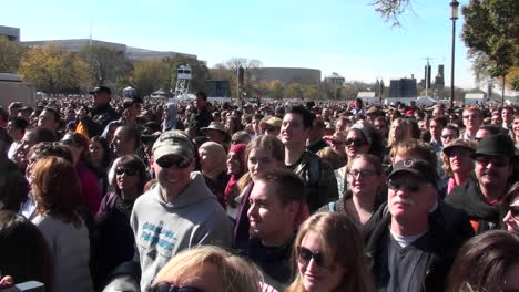 Crowds-of-protestors-on-the-mall-in-Washington-DC-jump-up-and-down-in-unison