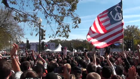 Protestors-fly-a-huge-American-flag-with-a-peace-sign-on-it-in-Washington-DC