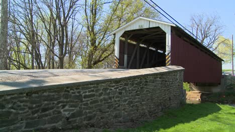 An-Amish-horse-and-buggy-cart-pass-through-a-covered-bridge-in-rural-Lancaster-Pennsylvania