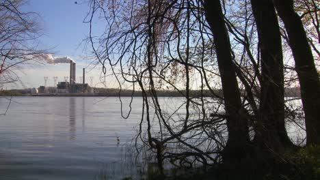 A-power-plant-with-smokestacks-near-a-river-2