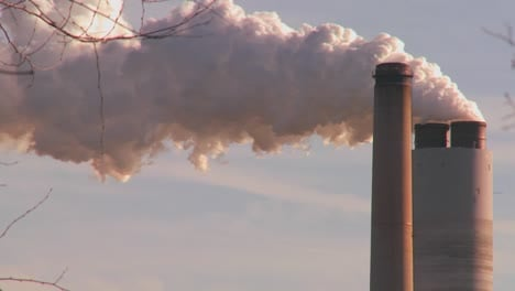 A-power-plant-with-smokestacks-belches-smoke-into-the-air