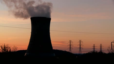 Time-lapse-shot-of-the-sun-setting-behind-a-nuclear-power-plant-1