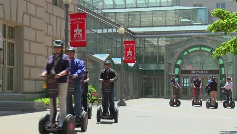 People-ride-segways-in-an-outdoor-area