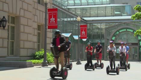 People-ride-segways-in-an-outdoor-area-1