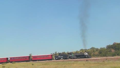 Panning-shot-of-a-steam-train-across-a-bluff