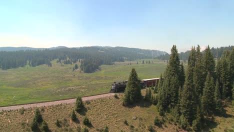 A-steam-train-passes-through-the-Rocky-Mountains