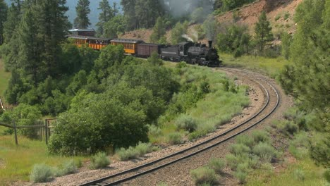 A-steam-train-moves-around-a-curve-in-the-Rocky-Mountains