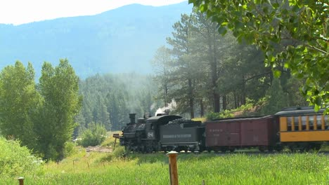A-steam-train-moves-travels-through-the-countryside-in-the-Rocky-Mountains