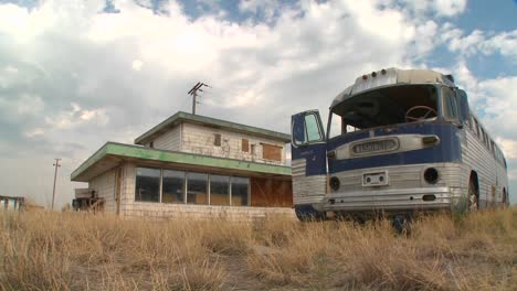 A-moving-time-lapse-shot-of-an-abandoned-Greyhound-bus-in-a-field-1