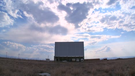 A-screen-under-a-big-sky-at-an-abandoned-drive-in-theater