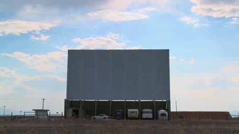 A-shot-of-clouds-passing-over-an-abandoned-drive-in-theater-screen