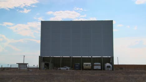 A-shot-of-clouds-passing-over-an-abandoned-drive-in-theater-screen-1
