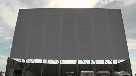 A-shot-of-clouds-passing-over-an-abandoned-drive-in-theater-screen-2