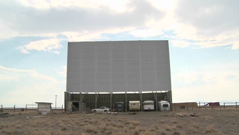 A-shot-of-clouds-passing-over-an-abandoned-drive-in-theater-screen-3