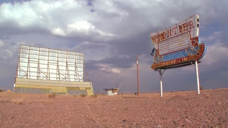 Clouds-pass-over-an-abandoned-drive-in-sign-and-screen-1