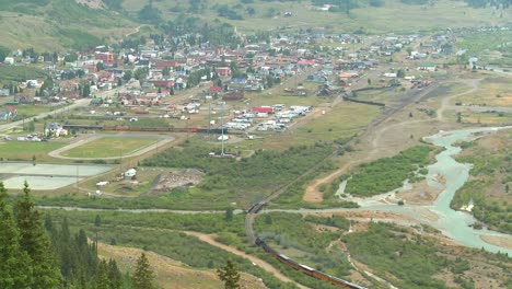 A-very-distant-shot-of-a-steam-train-arriving-in-Silverton-Colorado