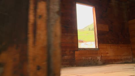 A-traveling-shot-moves-into-an-abandoned-house-in-a-ghost-town