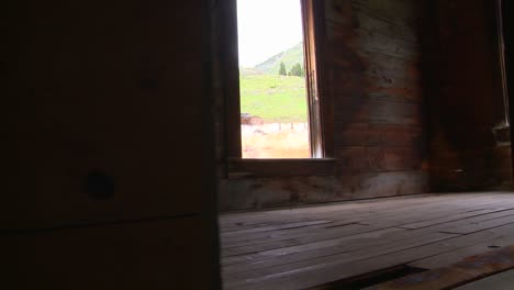 A-traveling-shot-moves-into-an-abandoned-house-in-a-ghost-town-1