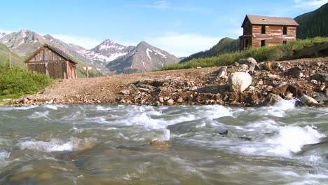 Colorado-ghost-town-with-river-flowing-foreground