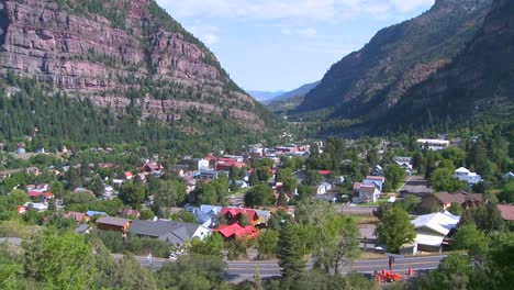 A-downtown-establishing-shot-of-Ouray-Colorado-with-steam-train-passing