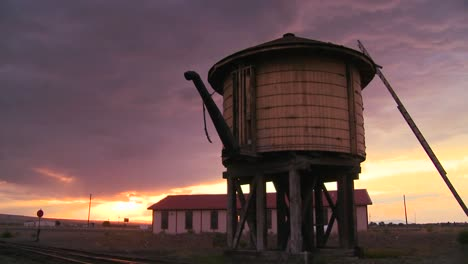 A-water-towers-along-an-abandoned-railroad-track-at-dusk