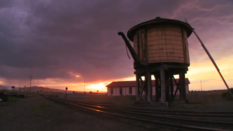 A-water-towers-along-an-abandoned-railroad-track-at-dusk-1