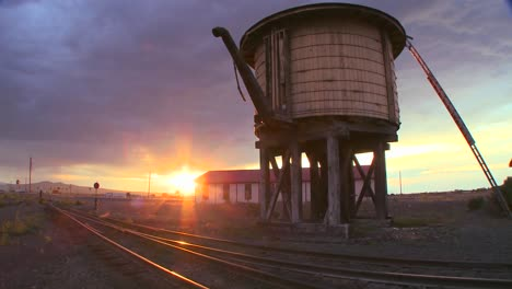 A-water-towers-along-an-abandoned-railroad-track-at-dusk-2