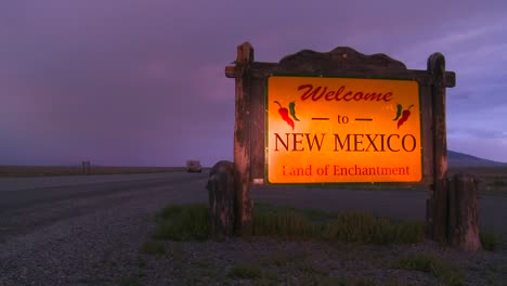 A-roadside-sign-welcomes-visitors-to-New-Mexico-as-a-motorhome-passes