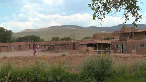 A-Native-American-Indian-girl-walks-near-the-Taos-pueblo-New-Mexico