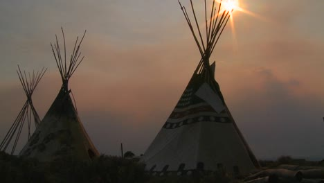 Indian-teepees-stand-in-a-native-american-encampment-at-sunset-1